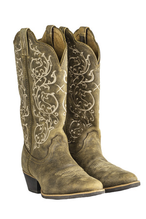 cowgirl and cowboy: A pair of brown ladies coyboy western boots isolated on a white. Stock Photo