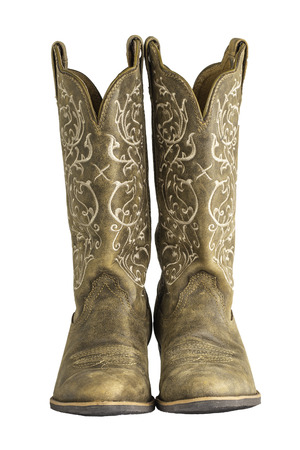 working cowboy: A pair of brown ladies coyboy western boots isolated on a white. Stock Photo