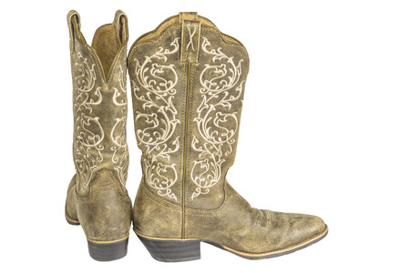 cowgirl boots: A pair of brown ladies coyboy western boots isolated on a white . Stock Photo