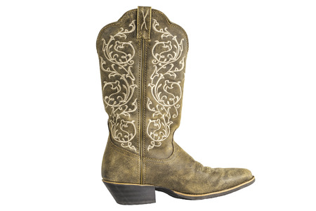 A brown ladies coyboy western boot isolated on a white. photo