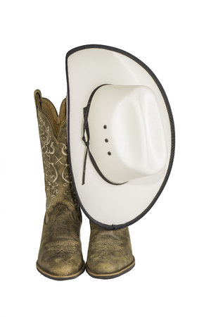 A pair of brown western boots and cowboy hat isolated on a white