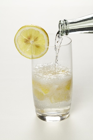 Mineral water with lemon when you pour
