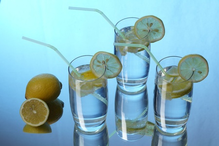 carbonic: Mineral water with lemon and reflection Stock Photo