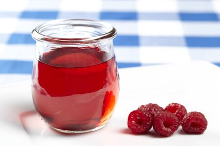 raspberry jelly: Raspberry jelly with berries Stock Photo