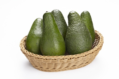 exempted: A basket of five avocados exempted on a white underground  Stock Photo
