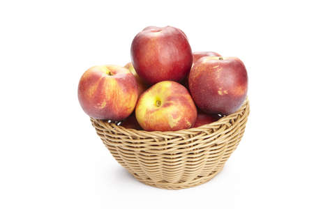 exempted: A basket of nectarines exempted on a white background