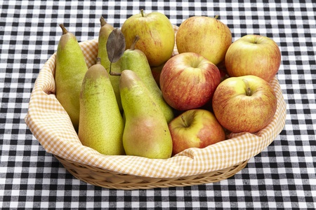 blackwhite: A basket of apples and pears on black-white checkered tablecloth