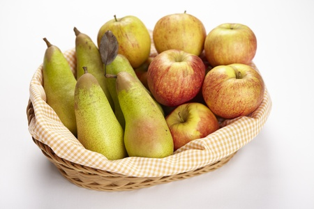 exempted: A basket of apples and pears exempted on a white background  Stock Photo