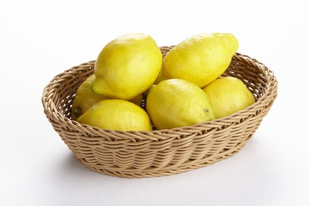 exempted: A basket of lemons exempted on a white background.