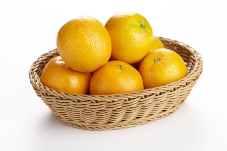 exempted: A basket of oranges exempted on a white background.