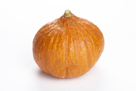 A hokkaido pumpkin exempted on a white background. Stock Photo