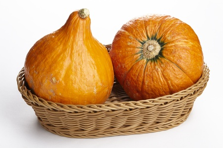exempted: Two hokkaido pumpkins into a basket. Stock Photo