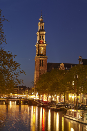 Canal and the Westerkerk (west church) in Amsterdam.