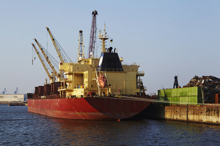 scrap iron: The picture shows the loading of scrap iron on a cargo vessel at the harbour of Hamburg. Stock Photo