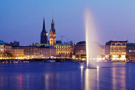 townhall: The picture shows the Inner Alster and the town hall taken in the evening.