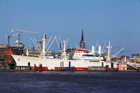 The museum ship Cap San Diego at the harbour of Hamburg taken from the opposite riverside of the Elbe.