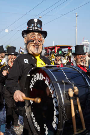 costumed: The Carnival at Basel (Basle - Switzerland) in the year 2014. The picture shows some costumed people.