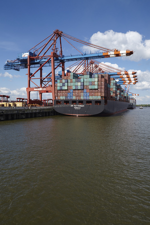 containership: The container vessel Zim Rotterdam is loadedunloaded at the container terminal Eurokai in Hamburg-Waltershof on May 2014, 03.