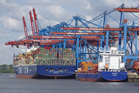 containership: The container vessels CMA CGM Jules Verne and Emotion are loadedunloaded at the container terminal Burchardkai in Hamburg-Waltershof on May 2014, 03. Editorial