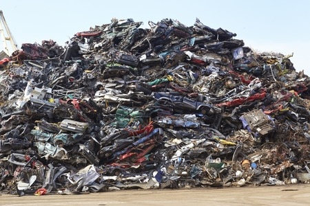 discarded metal: A pile of scrap metal (iron) is waiting to recycle the discarded metal.