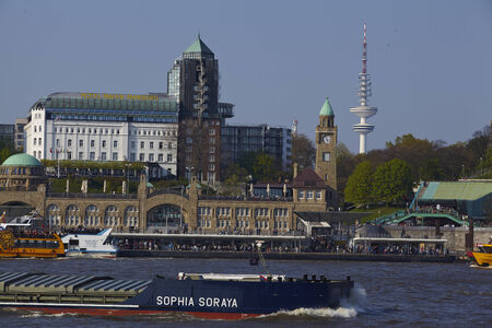 The St. Pauli jetties and the television tower at the port of Hamburg with the freighter Sophia Soraya on April 2014, 19.