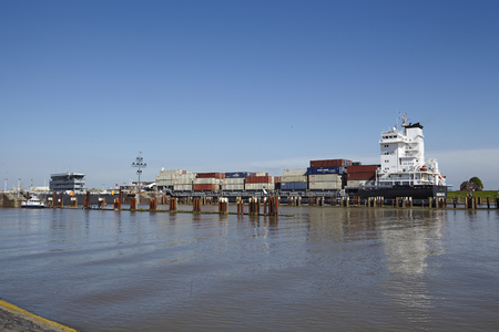 The container vessel Sonderborg Strait at the arrival of the lockage Brunsbuettel on May 2014, 17  Editorial