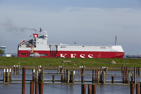 car carrier: The freighter  car carrier  Main Highway at the departure of the lockage Brunsbuettel on May 2014, 17
