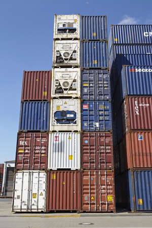 A pile of containers (FEU) and refrigerated containers at the Port of Hamburg taken at bright sunlight on May 17, 2014.