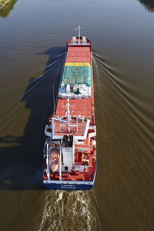 boles: The freighter Lammy at the Kiel Canal near Beldorf (Schleswig-Holstein, Germany) loaded with tree boles on June 8, 2014. Editorial