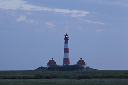 westerhever: The light-house at Westerhever near St. Peter Ording (Germany, Schleswig-Holstein) in the evening.