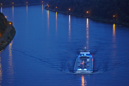 The tanker TMS Cascade at the Kiel Canal near Beldorf (Germany, Schleswig-Holstein) taken in the evening on June 15, 2014.