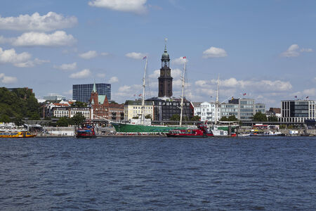 st michel: The St. Michaelis Church at the Harbor of Hamburg taken at bright sunlight with blue sky and white clouds on August 8, 2014.