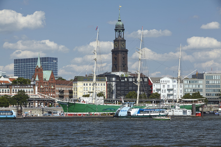 The St. Michaelis Church at the Harbor of Hamburg taken at bright sunlight with blue sky and white clouds on August 8, 2014.