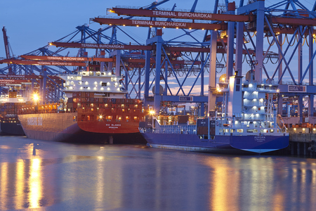sued: The container vessels Rio Blanco (Hamburg Sued) and Aurora are loaded  unloaded at the terminal Burchardkai in the deepwater port Hamburg-Waltershof on August 8, 2014.