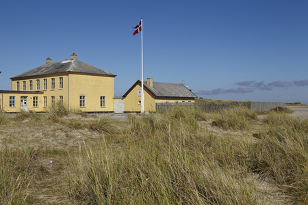 The lighthouse Grenen (called Grey Tower) near Skagen (Denmark, North Jutland) at the junction of Skagerrak (North Sea) and Kattegat (Baltic Sea) is the second highest Danish lighthouse.  Stock Photo