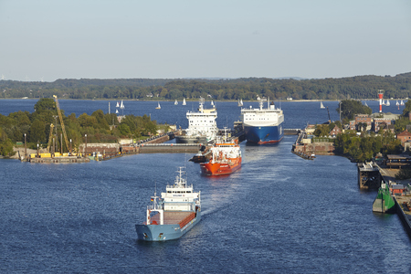 The genral cargo ship Wilson Hawk, tanker Eduard Essberger and Ro-ro cargo vessel Finnbreeze are leaving the lock Kiel-Holtenau to the Kiel Canal on September 3, 2014. Editorial
