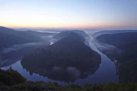 saar: The Saar Loop (Saarland, Germany) near Mettlach at sunrise with some fog and haze.