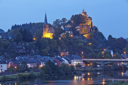 The Evangelic Church and the Castle Saarburg at Saarburg (Rhineland-Palatinate, Germany) taken in the evening on October 4, 2014.
