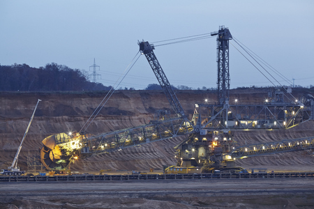 rwe: A rotary excavator at the soft coal open cast mining Hambach at Northrhine Westphalia (Germany) on the municipal of Niederzier and Elsdorf taken on November 23, 2014. Editorial