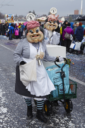 costumed: The Carnival at Basel (Basle - Switzerland) in the year 2015. The picture shows some costumed people on February 23, 2015.