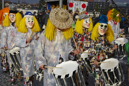 clique: The Carnival at Basel (Basle - Switzerland) in the year 2015. The picture shows some costumed people on February 23, 2015.