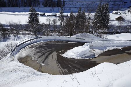 switchback: An U-turn of a switchback (road) with much of snow in the Swiss canton Ticino (Tessin) taken in winter near the Gotthard massif, Stock Photo
