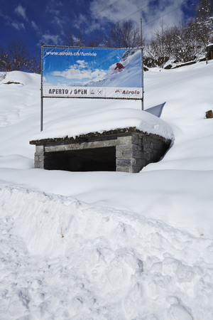 Ski Area: Banner in Airolo (Ticino, Switzerland) to advertise the ski area at the St. Gotthard taken on February 22, 2015. Editorial