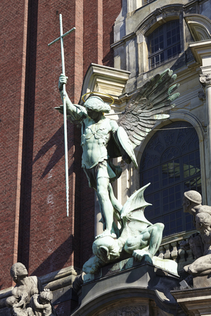 The figure of the archangel Michael is located above the main entrance of the St. Michaelis Church (Michel) in Hamburg (Germany).