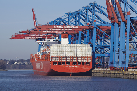 The container vessel Cap San Antonio (Hamburg Sued) is loaded and unloaded at the terminal Burchardkai at the Port of Hamburg Waltershof (Germany) on March 8, 2015.