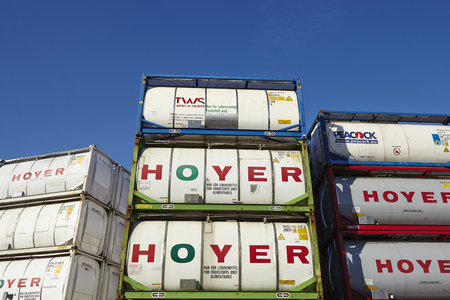 A pile of tank container (tanktainer) of different haulage firms taken at the port of Hamburg against a bright blue sky on March 8, 2015.
