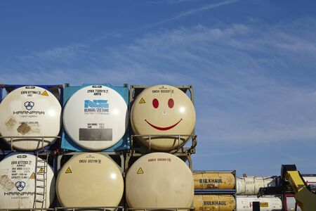 haulage: A pile of tank container (tanktainer) of different haulage firms taken at the port of Hamburg against a bright blue sky on March 8, 2015.