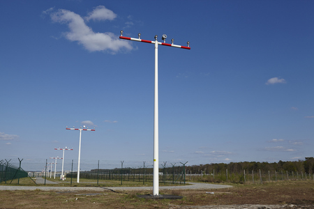 masts: Some beaconing masts at the Frankfurt Airport (Germany) with a blue sky and white clouds on April 18, 2015.
