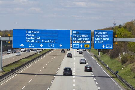 autobahn: The federal Autobahn A5 beneath the Airport of Frankfurt (Germany) in direction to the Frankfurt Kreuz with a road sign to the airport taken on April 18, 2015.