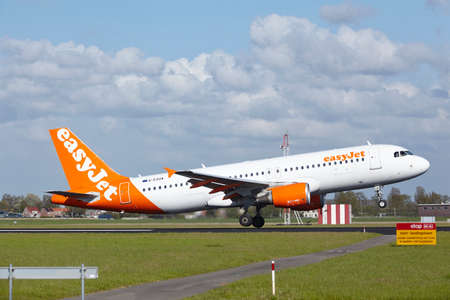 polderbaan: An Airbus A320-214 of EasyJet lands at Amsterdam Airport Schiphol (The Netherlands, AMS) on May 7, 2015. The name of the runway is Polderbaan.